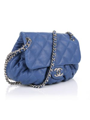 Indigo Oval Quilted Handbag by Chanel - Le Dressing Monaco