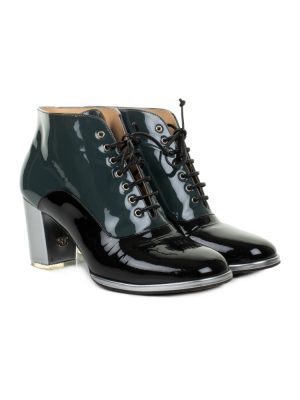 Bicolor Patent Leather Ankle Boots by Chanel Available at Le Dressing